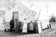 Family posing in front of their temporary oilfield house, 1914
