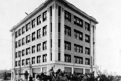 Construction workers pose in front of Pioneer Building, 4th & Boston, following its completion, 1911
