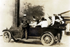 Group of armed white men in a car during the Tulsa Race Massacre, 1921