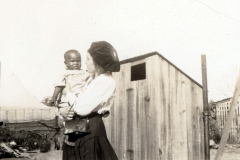 Red Cross worker holding young victim of Tulsa Race Massacre
