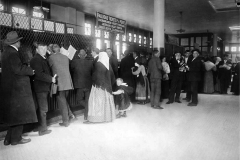 immigrants buying railroad tickets