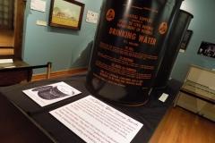 View of Civil Defense Water Storage Barrel in exhibit