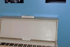 Honey Hudgen's 3/4-size piano in exhibit