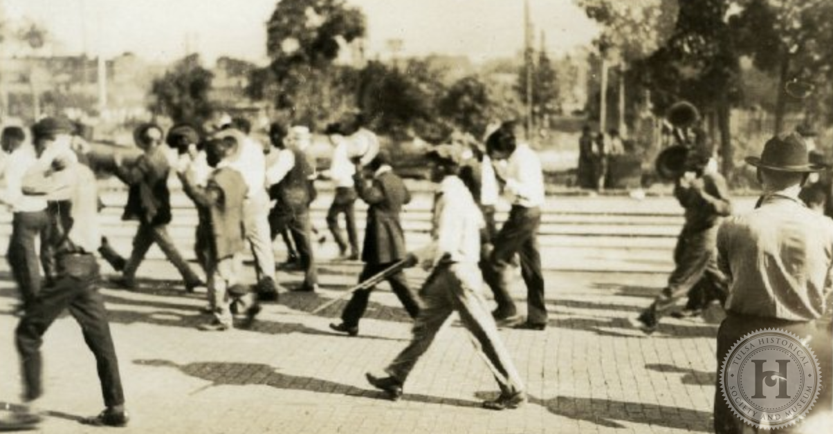 African American prisoners being marched at gunpoint.